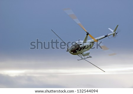 helicopter spraying fertiliser on a crop in Westland, New Zealand - stock photo