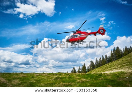 Helicopter takeoff in the mountains - stock photo