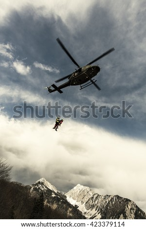 Helicopter with medic team arrived at the scene of an accident. - stock photo