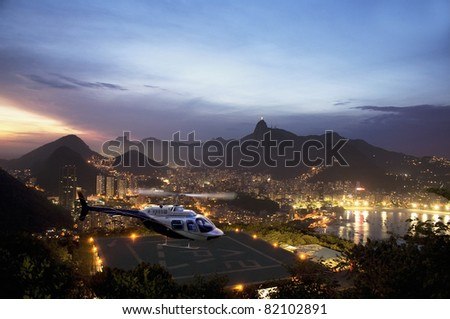Helicopter with  Rio De Janeiro in background.