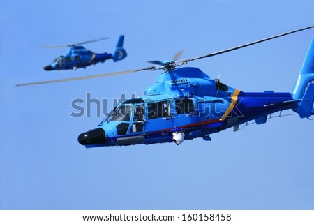 Helicopters making patrol - stock photo