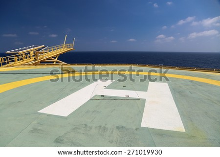 Helideck of oil and gas drilling rig in offshore industry, Helicopter landing area on construction platform in offshore of oil and gas industry or energy business for transfer passenger. - stock photo