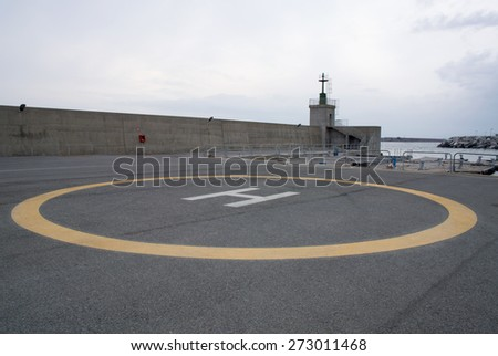 helipad on the dock of a port