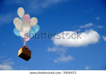 Helium balloons is lifting basket with people. - stock photo