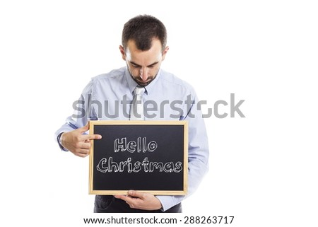 Hello Christmas -Young businessman with blackboard - isolated on white