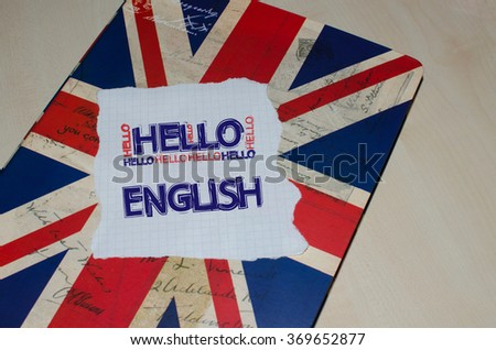 Hello English written on piece of paper.  English learning concept