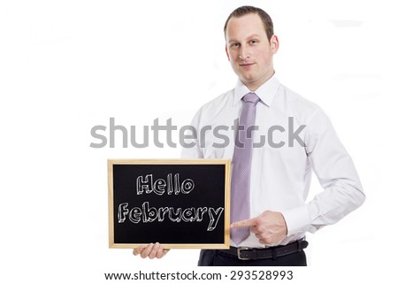 Hello February -Young businessman with blackboard - isolated on white