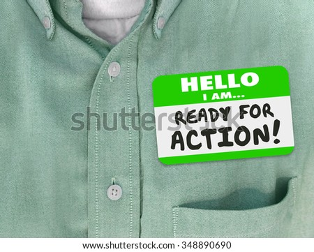Hello I Am Ready for Action words written on green nametag sticker on a shirt of an employee or worker  - stock photo