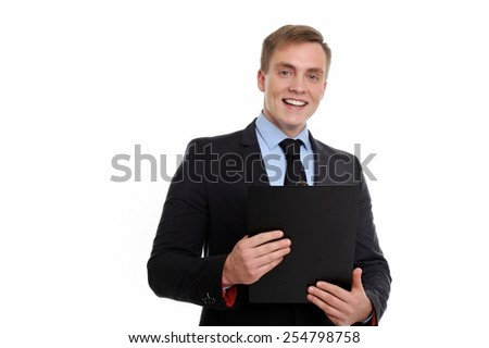 Hello, I will be happy to help you. Portrait of a smiling businessman holding clipboard isolated on white background.
