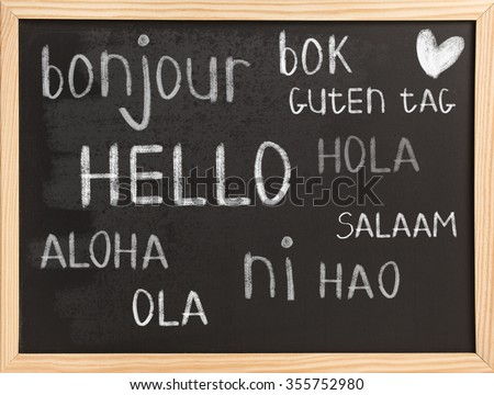 Hello in different languages on chalkboard background - stock photo