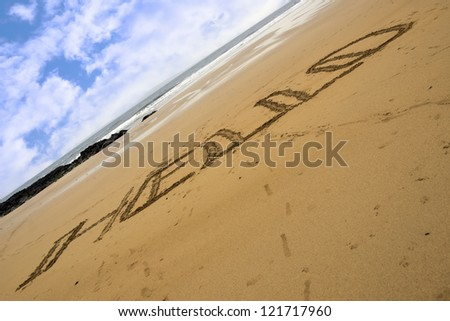 Hello inscribed on a sandy beach in Ballybunion Ireland - stock photo