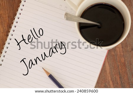 Hello January text write on book  - stock photo