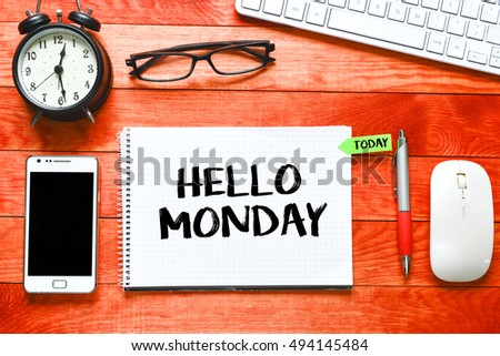 Hello monday/ Blank album paper with hello monday inscription on table with office items