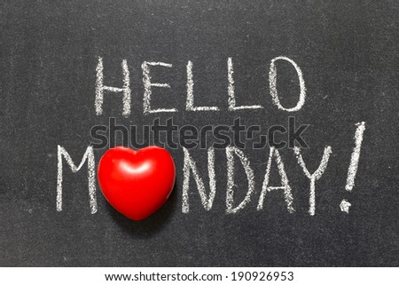 hello Monday exclamation handwritten on chalkboard with heart symbol instead of O