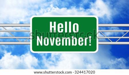 Hello November! Green Road Sign - stock photo
