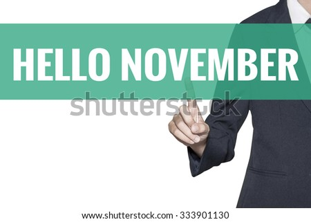 Hello November word on virtual screen touch by business woman on white background - stock photo