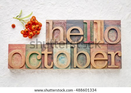 hello October greeting card - letterpress wood type blocks against white lokta paper with firethorn berries