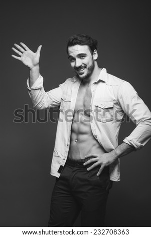 hello sign shown by a sexy man with beard and unbuttoned shirt, black and white