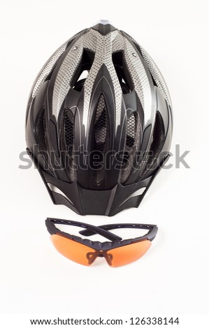 Helmet and bicycle glasses on a white background - stock photo