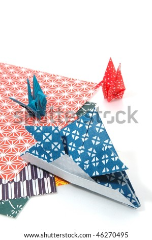 Helmet and crane of paper - stock photo