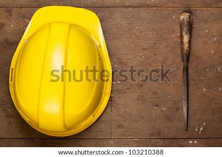 Helmet and rasp on grunge wood - stock photo
