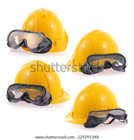 Helmet and Safety glasses set isolated on a white background. - stock photo