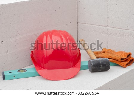 helmet and tools are on the aerated concrete blocks - stock photo