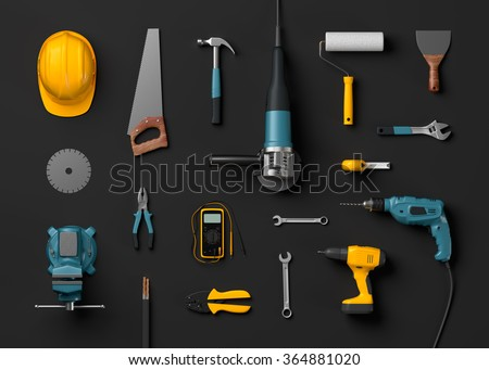 helmet, drill, angle grinder and construction tools on a black isolated background - stock photo