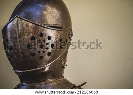 helmet head, medieval armor made of wrought iron - stock photo