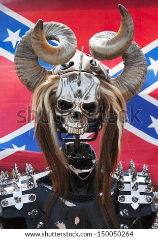 helmet in the form of a skull with horns against the Confederate flag - stock photo
