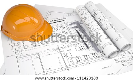 Helmet on the construction drawings. Isolated on white background - stock photo