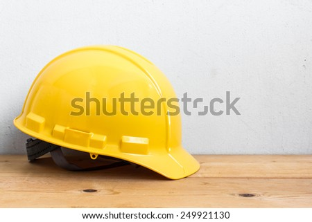 Helmet Safety On Wood Table - stock photo