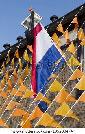 HELMOND, THE NETHERLANDS - JUNE 14: A highschool student who has just graduated from high school has put up his or her graduation flag and banners in Helmond, The Netherlands on June 14, 2012. - stock photo