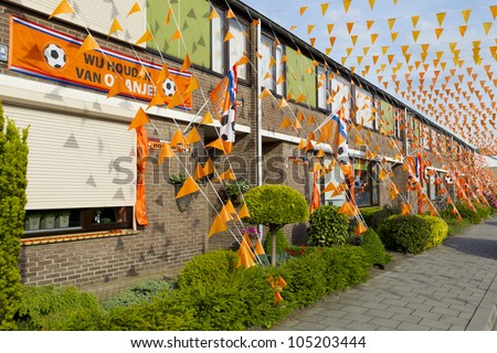 HELMOND, THE NETHERLANDS - JUNE 14: Soccer fans have put up street decorations for the European Soccer Championships 2012 in Helmond, The Netherlands on June 14, 2012. - stock photo
