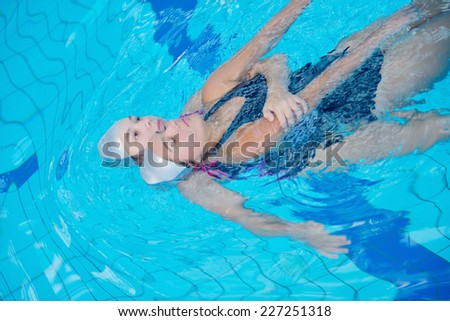 help and rescue action in swimming school at pool