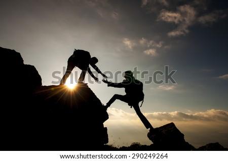 help climbing a mountain - stock photo
