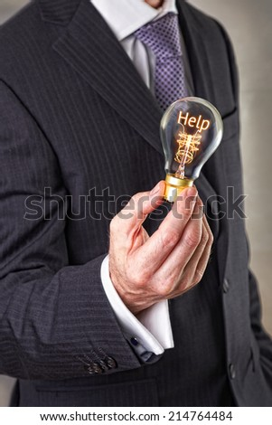 Help concept in a filament lightbulb.