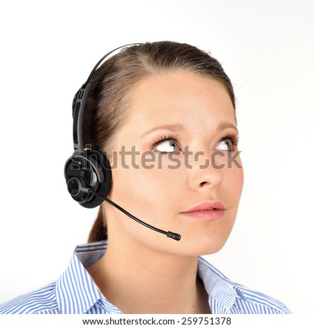 Help desk woman with headset on wearing a blue white striped blouse