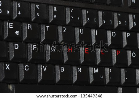 help diagonally in red writing on a computer keyboard