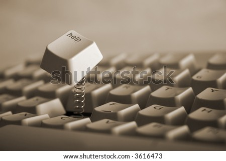 Help key jumping out of keyboard with a spring. - stock photo