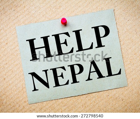 HELP NEPAL Note. Recycled paper note pinned on cork board. Concept Image - stock photo