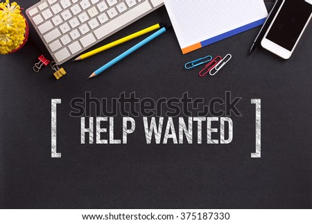 HELP WANTED CONCEPT ON BLACKBOARD - stock photo