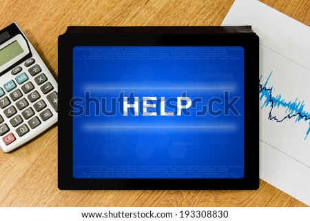 help word on digital tablet with calculator and financial graph - stock photo