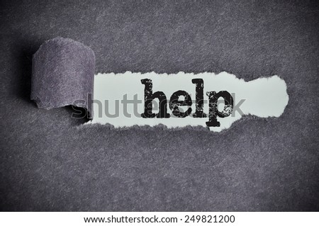 help  word under torn black sugar paper  - stock photo