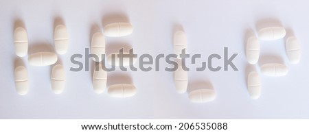 Help written with medical pills - stock photo
