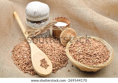 Helpful food dietary, Groats buckwheat cereals salt salt shaker on the background from a sacking
