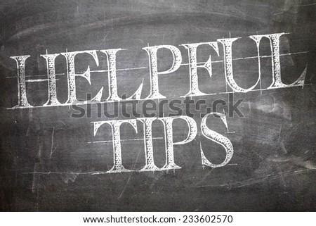 Helpful Tips written on blackboard - stock photo
