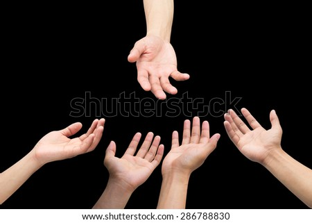 helping hand and group of praying human hand on black background:collaborate healing together concept:improve natives life idea:giving good living,education,food,money conceptual:love,care:human right - stock photo