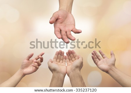helping hand and hands prayer over blurred white cross (sign of christ religion) on golden color  background with bokeh circle light,helping hand concept.religious concept. - stock photo