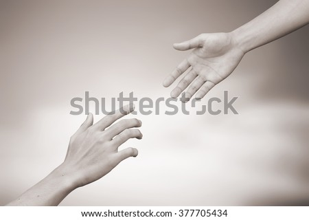 helping hand and hands praying.forgiveness conceptual.people give the power to people.abstract support/cheerful concept in sepia vintage tone color:spiritual of faith:together/heal:poverty population - stock photo